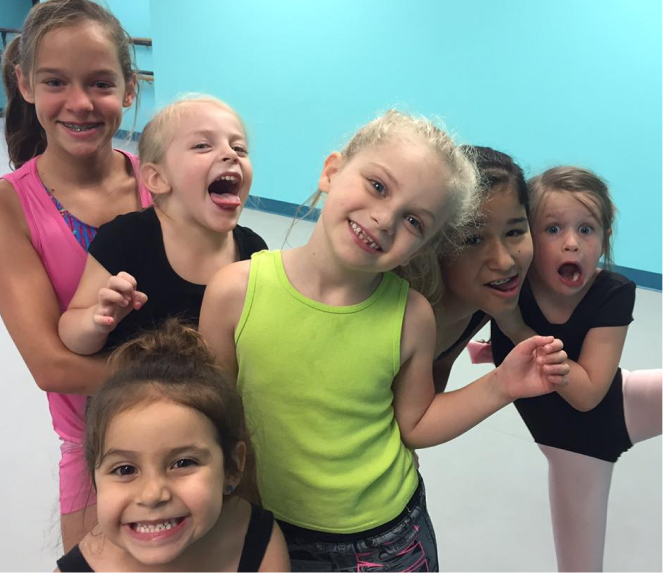 children smiling at dance class