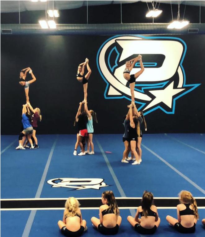 cheerleaders practicing stunts