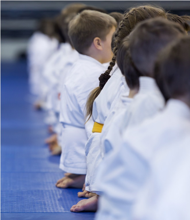 students sitting in a martial arts class