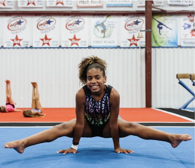 female gymnast doing the splits