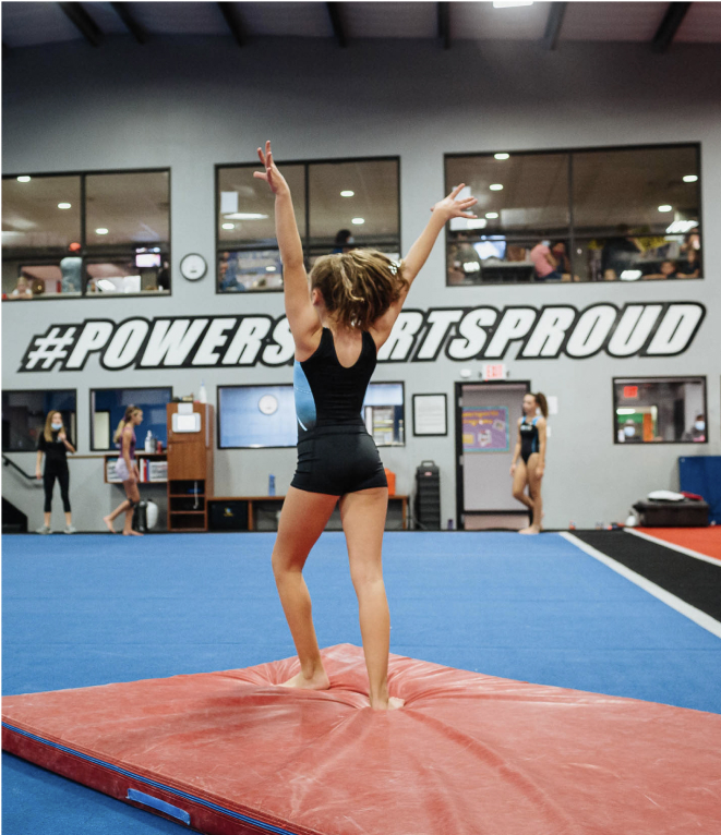 female gymnast practicing a floor routine