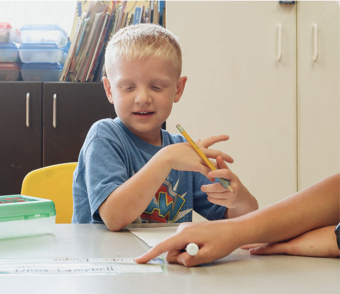 boy at afterschool care doing homework