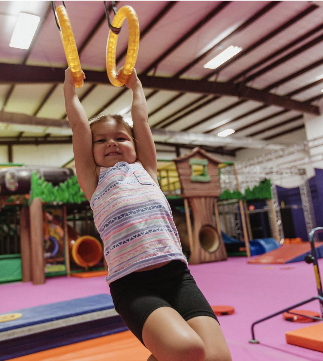 preschooler on gymnastics rings