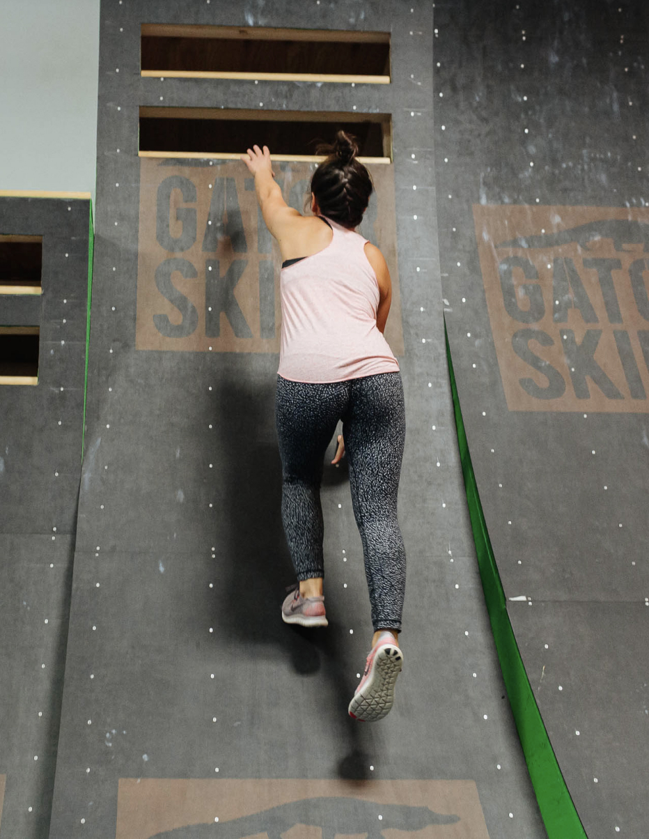 woman on the warped wall on ninja warrior course