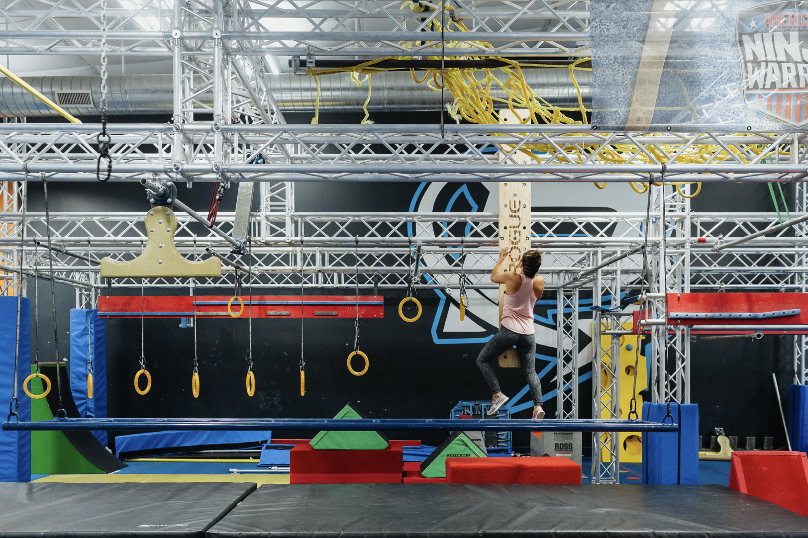 woman on powersports ninja warrior course