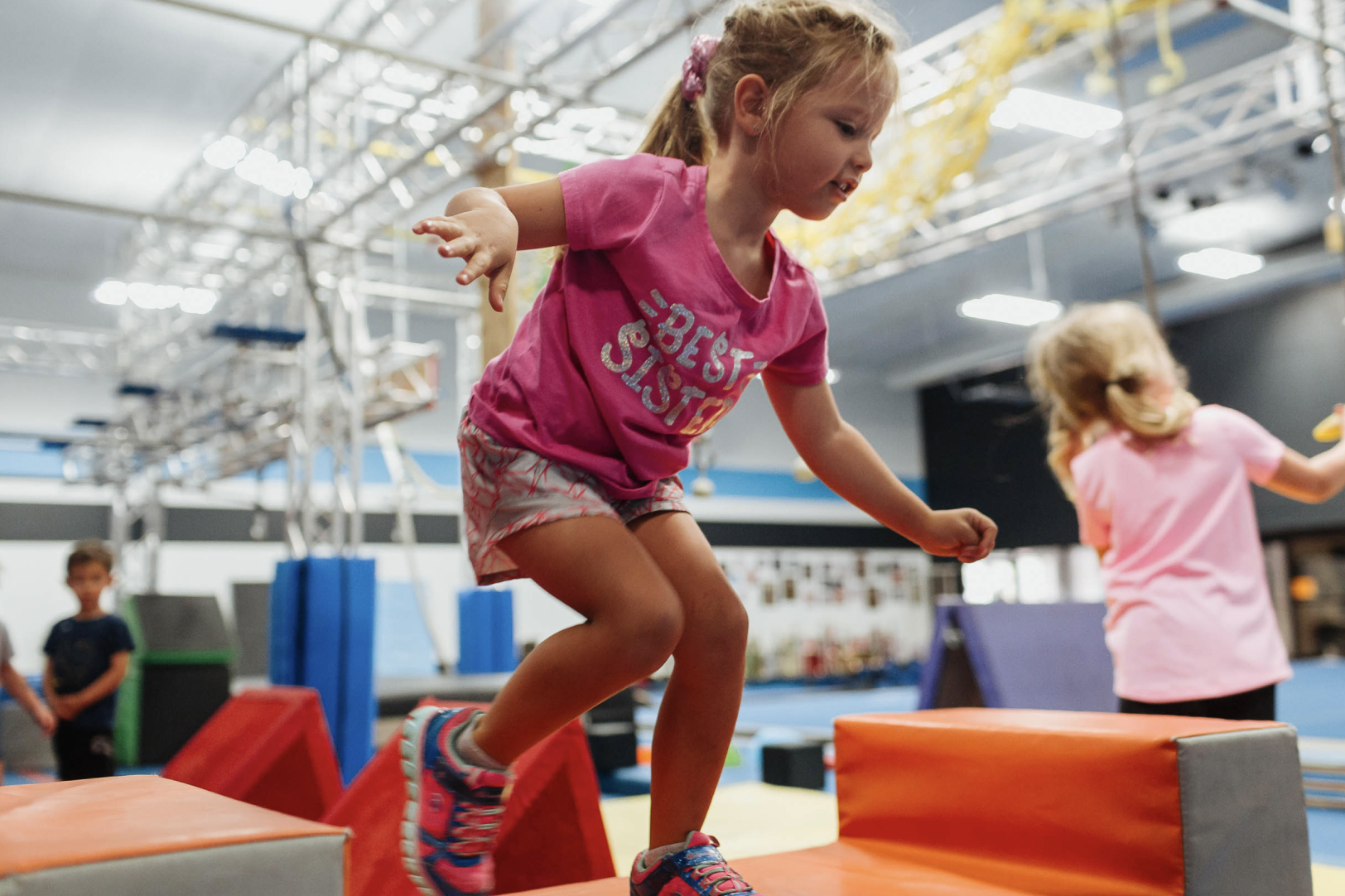 kids using an obstacle course